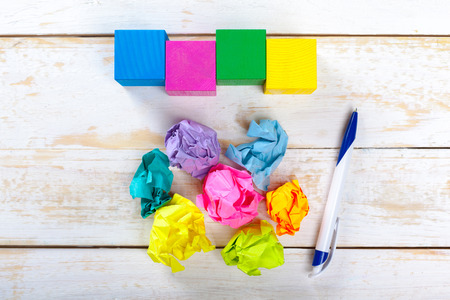 stress ball: Colorful crumpled paper on a wooden table Stock Photo