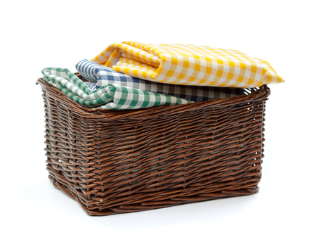 Clothes in a laundry wooden basket isolated on white background Stock Photo