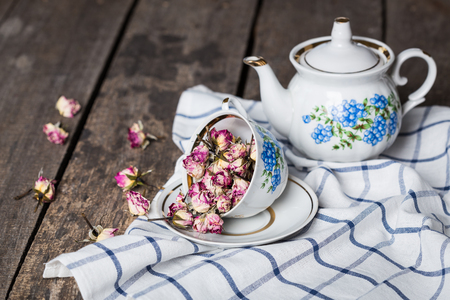 tarde de cafe: still life with tea cup and tablecloth on wooden table