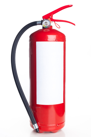 Red fire extinguisher isolated on white