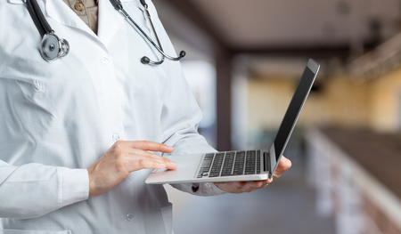 Hands of medical doctor woman with laptop Stock Photo