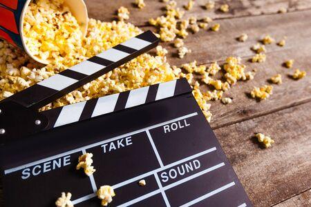Movie clapper board and pop corn Reklamní fotografie
