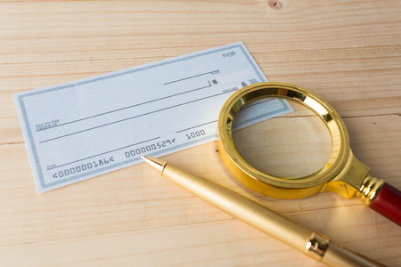 Banking Check with magnifier glass