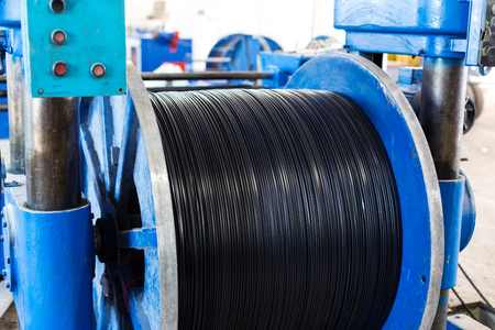 ferrous foundry: Inside the old factory manufacturing electrical cable. Stock Photo