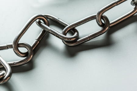 close up of metal chain part on white background Stock Photo