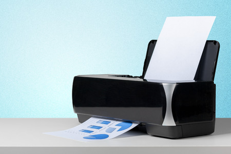 Printer on white desk Stock Photo