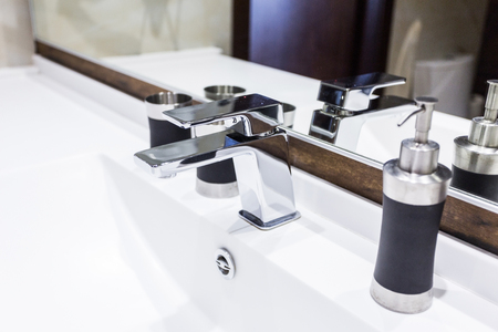 washbasin and faucet at home Stock Photo