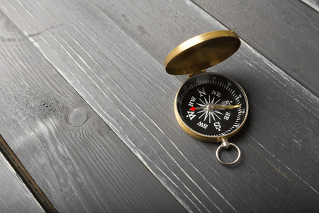 compass on the wooden table background