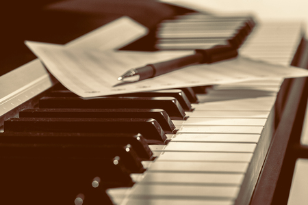 musical score: music notes on piano keys
