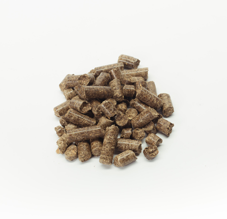 crucible: stack of wooden pellets for bio energy, white background, isolated