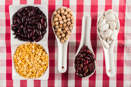 green bean: mix of beans on wooden table Stock Photo