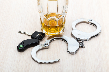 dwi: Car key on the bar with spilled alcohol