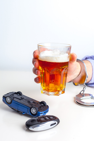 Drunk Driving Concept - Beer, Keys and Handcuffs