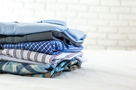 closet: close up of ironed and folded shirts on table at home Stock Photo