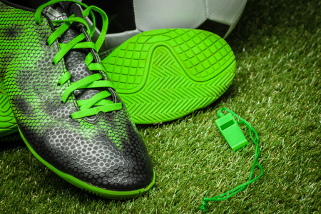 soccer ball and cleats on the football field Stock Photo