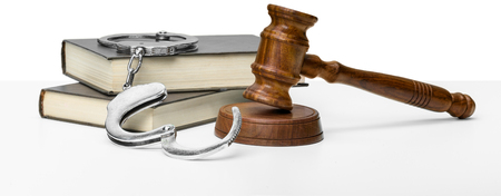 Gavel, books and handcuffs Stock Photo