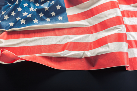 advertise with us: American flag on dark background