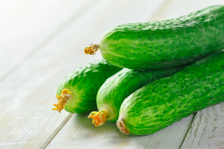 full willow: cucumbers on wooden background Stock Photo