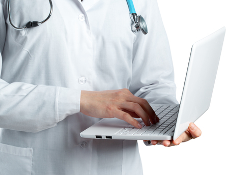 astonishing: Female doctor holding a laptop, isolated on white background Stock Photo