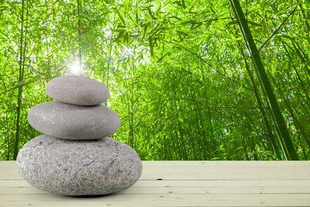 Zen stones on wooden surface Stock Photo