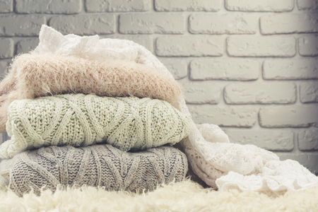 closet: Stack of cozy knitted sweaters Stock Photo