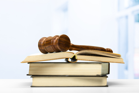 Wooden gavel and books on wooden table Stock Photo