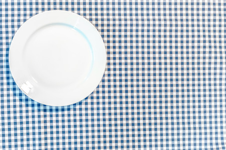 diagonal: table with blue picnic cloth and plate