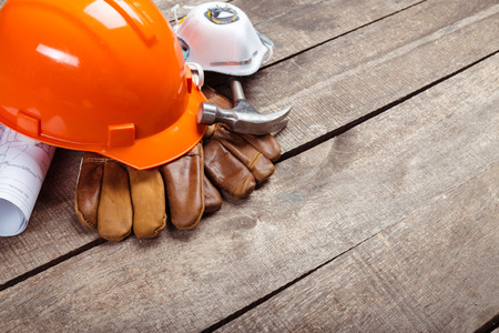 hardhat and old leather gloves Stock Photo