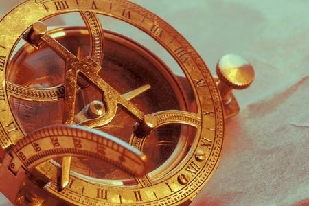 antique compass on vintage paper background