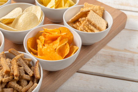 pretzel stick: Pretzels in bowls on wooden table from above Stock Photo