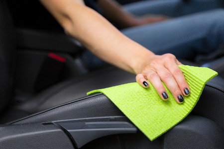 microfiber: Hand with microfiber cloth cleaning car