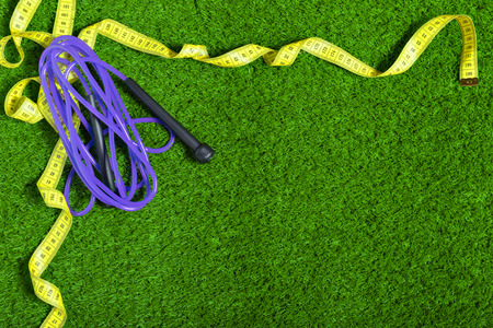 Jump ropes on grass.