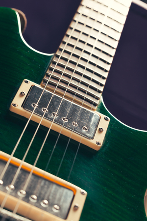 Electric guitar body and neck detail on wooden background Stock Photo
