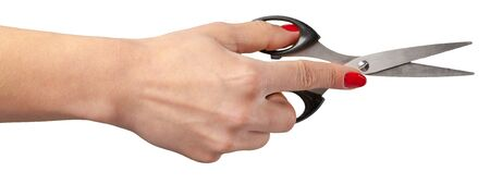 haircutting: the hand of a Barber holding a scissors