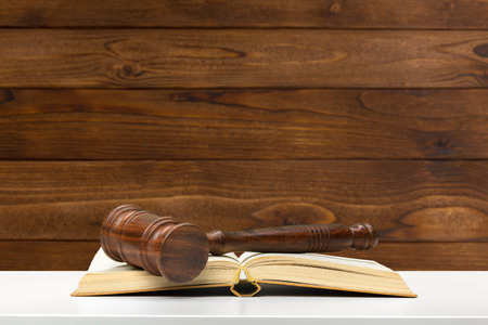 auctioning: Wooden gavel and books on wooden table Stock Photo