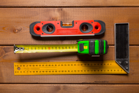 millimeter: Tape measure on wooden background. top view. Stock Photo