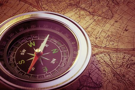 antiquity: Old compass on vintage map