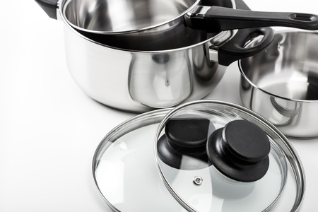 saute: Stainless steel pots and pans isolated on white