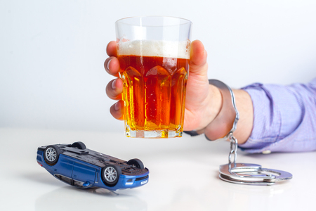 alcoholismo: Drunk Driving Concept - Beer, Keys and Handcuffs