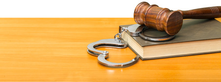 Gavel, books and handcuffs Stock Photo