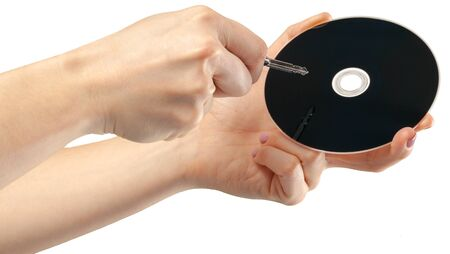 hand holds a compact disk(cd) isolated Stock Photo