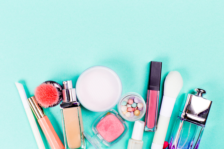 Colorful cosmetics on blue workplace. Top view Stock Photo
