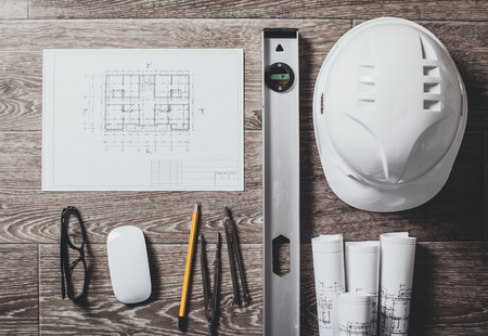 construction project: Project drawings and tools, close up Stock Photo