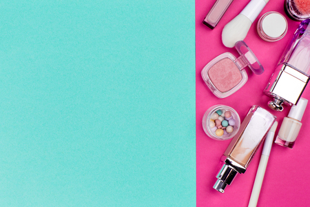 Set of colorful cosmetics on pink table Imagens