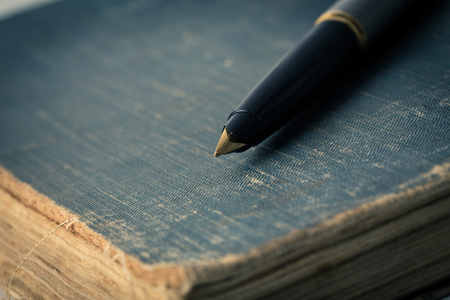 details: Vintage books and pen Stock Photo