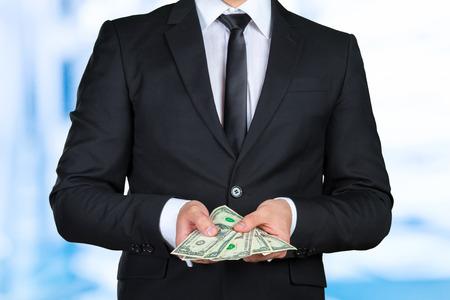 Unrecognizable businessman shows dollar banknote Stock Photo