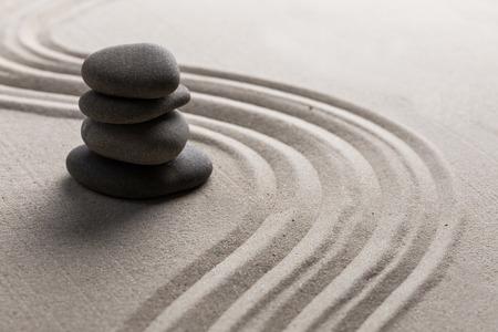 curve road: zen stone garden round stone and raked sand Stock Photo