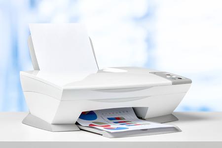 Printer on white desk Stock Photo