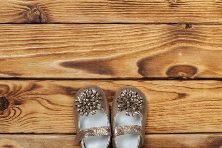 babys bootee on wooden background