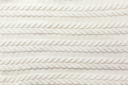 cable stitch: White wool sweater background Stock Photo